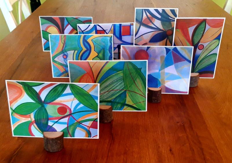 "Kunstpostkarten ""Aufbruch"", ""Nach dem Regen"", ""Sonnengong"", ""Haiway"", ""Vorhang auf"", ""o.T."", ""Blau, Rot, Gold"", ""Jungle Lights"""
