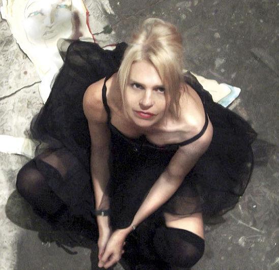 Vocalist Belinda Blair sitting on the floor in a tutu.