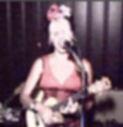 Singer Belinda Blair playing ukulele and belting it out with her band.