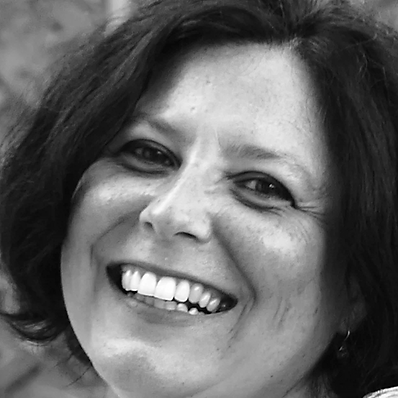 Headshot photo of Ana B. woman with short brown hair