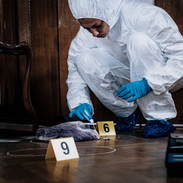 forensic-expert-searching-for-clues-4TQN