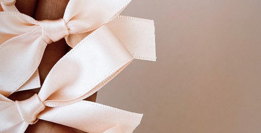 Soft peach satin bows