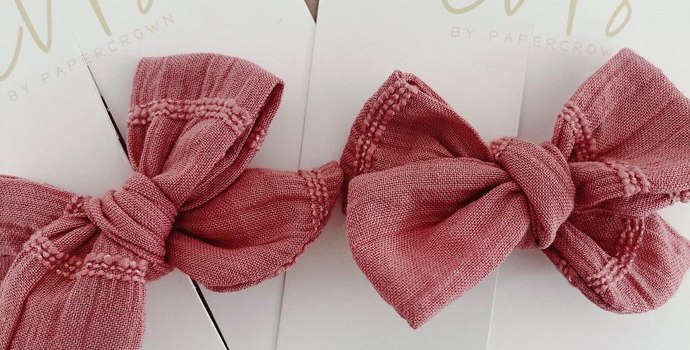 Coral braid bow