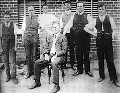 Staff of the Manilla Express pictured outside premises eastern side of Manilla Street 1910s. Cecil Vincent seated.