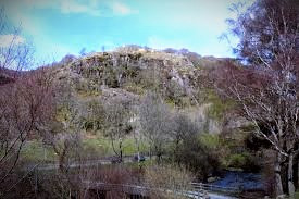 Dinas Emyrs, the hill on which Merlin foretold the victory of the Red Dragon over the White.