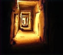 Passageway in the Knowth, Ireland cairn temple floods with light at sunrise at the Spring ad Autumnal Equinoxes.