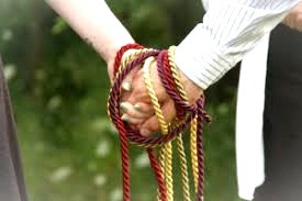 Handfasting, the traditional Celtic marriage ritual, is now often a part of modern weddings.