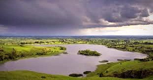 A storm cloud over Lough Gur.  According to folklore, the goddess, Aine, banished her husband, an Earl of Desmond, into the lake.