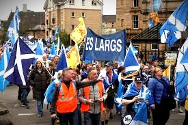A sea of Scottish flags and a few YES signs are carried at a 2018 rally to call for Independence for Scotland.
