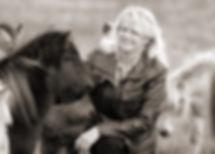 Fine art photographer Linda Finstad stroking a pony