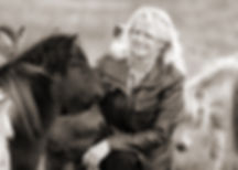 Fine art photographer Linda Finstad stroking a pony