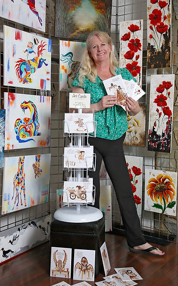 linda with cards standing.jpg