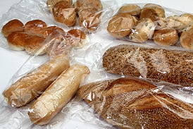 bread and cookies stored in cellophane b