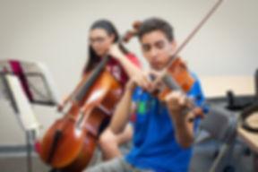 Boy playing viola, girl playing cello