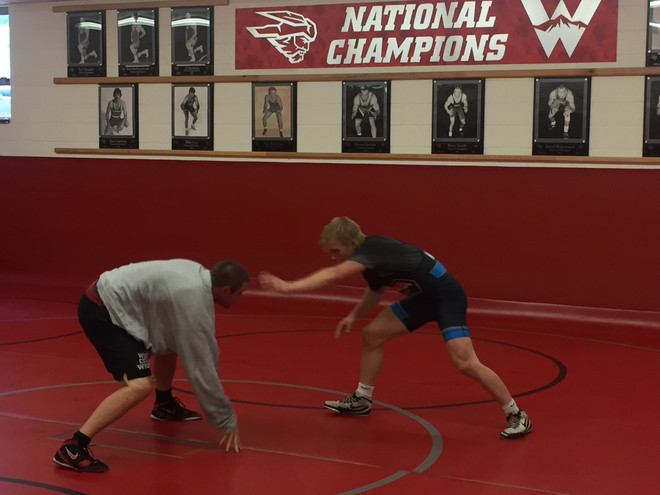 Coach Pipher and Hunter Mullin working out