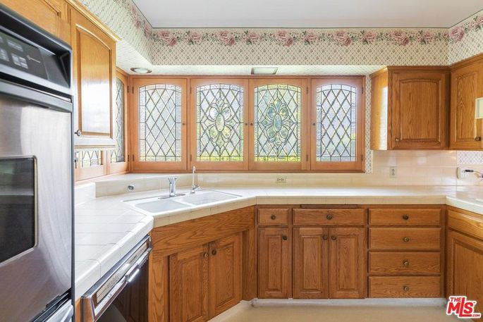 The actual kitchen is mostly white and brown.  -  realtor.com