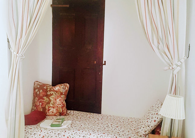 Upstairs common area – small nook, a cozy sleeping area for 1 adult or child.