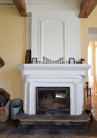 Living room fireplace with insert.