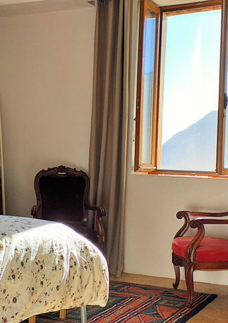 Upstairs, a large bedroom with view of the village and the Gorge.