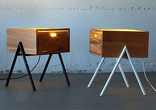 A combination of a table and lamp