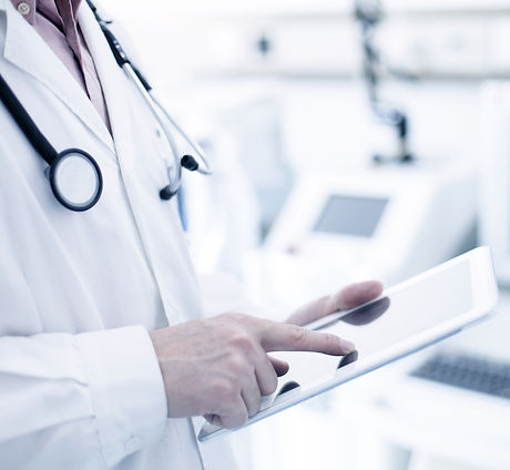Doctor Using Digital Tablet_edited.jpg