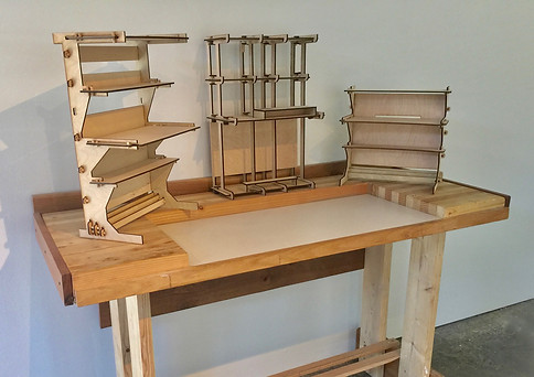 Table of flat pack desk prototypes.