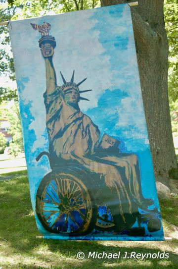 A canvas painting of the Statue of Liberty in a wheelchair.