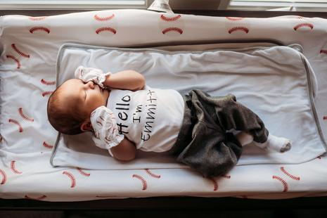 Newborn in baseball nursery in Buffalo.