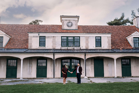 Expecting couple in front of the stables at Knox Farm during maternity photos.