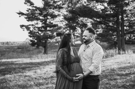 Parents-to-be laughing during maternity session at Knox Farm.