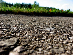 Closeup_of_pavement_with_grass.jpeg