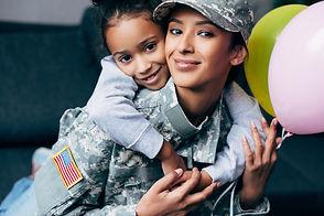 african american daughter hugging her mo