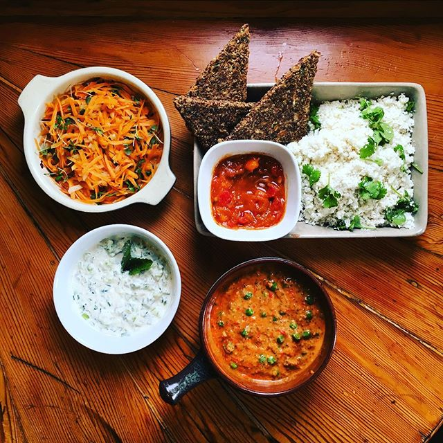 Raw food supper at the Whole Truth Retreat: Tomato & Pea Chia Curry with Cauliflower Rice, Carrot-Orange Sambal, Mango Chutney, Minted Cucumber Cashew Yoghurt and Spiced Onion Flatbread.