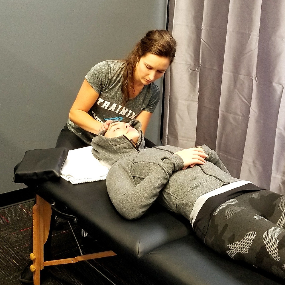 Courtney Sanders providing a manual therapy treatment