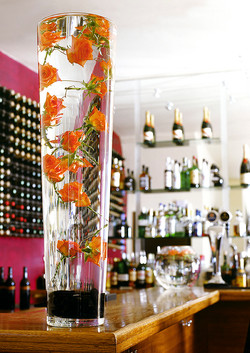 Tall glass on bar