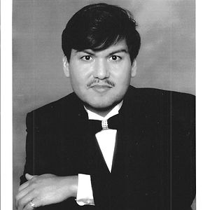 Winner of the Chicago Park District Talent Search, a graduate of the Chicago Musical College; advanced studies in opera at the Graz Institute, Austria; Liturgy and Music studies at St. Joseph's College, Indiana; former member of the Chicago Symphony Chorus and Lyric Opera Chorus of Chicago.