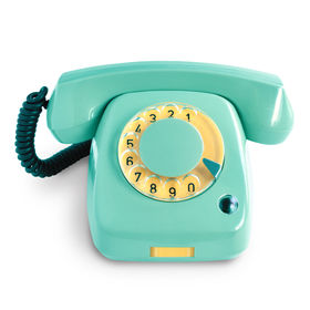 Vintage green telephone with rotary dial