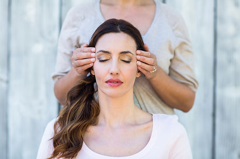 Canva - Woman getting reiki therapy.jpg