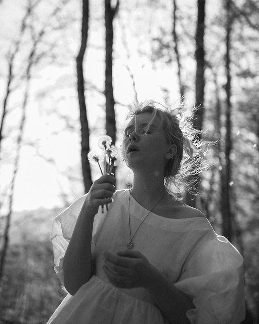 girl with dandelion heads.jpg
