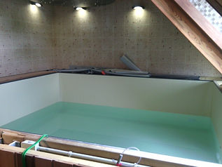 Mise en place de la membrane d'étanchéité et remplissage du bassin