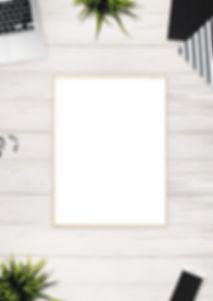 photo-of-brown-photo-frame-near-laptop-1