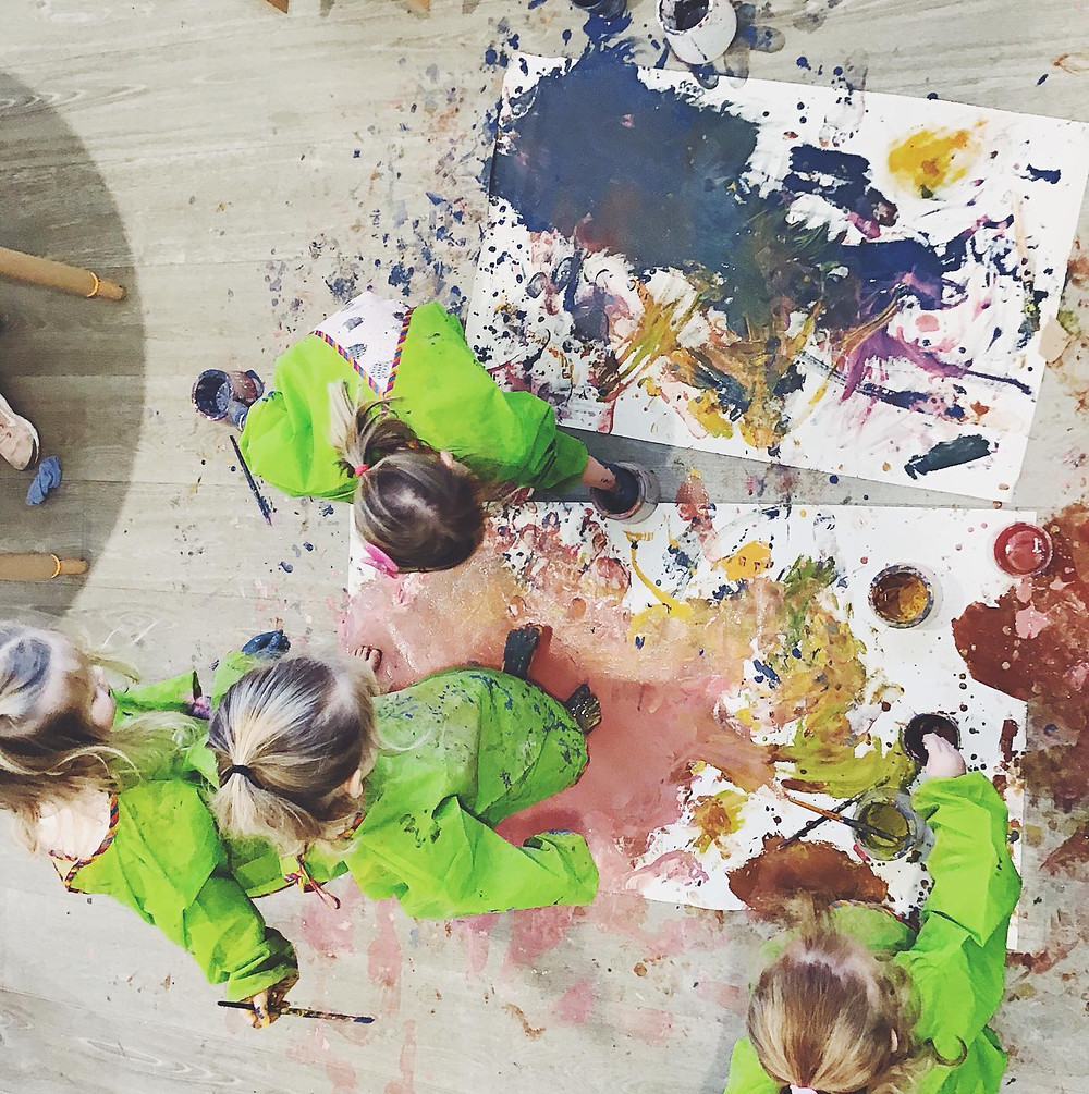 A group of children painting