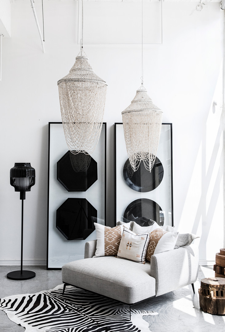 Natural Shell Chandelier, Geometric Bamboo Wall Hanging, Tommy Love Seat & Bamboo Standing Lamp