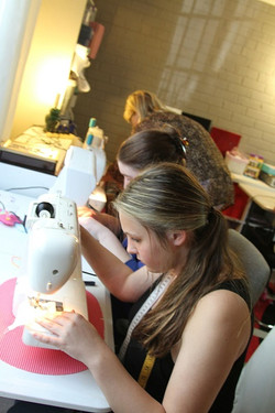 "STUDENTS  AT WORK ON MACHINE""Learn2sew School of Fashion Gold Coast and Sydney"""