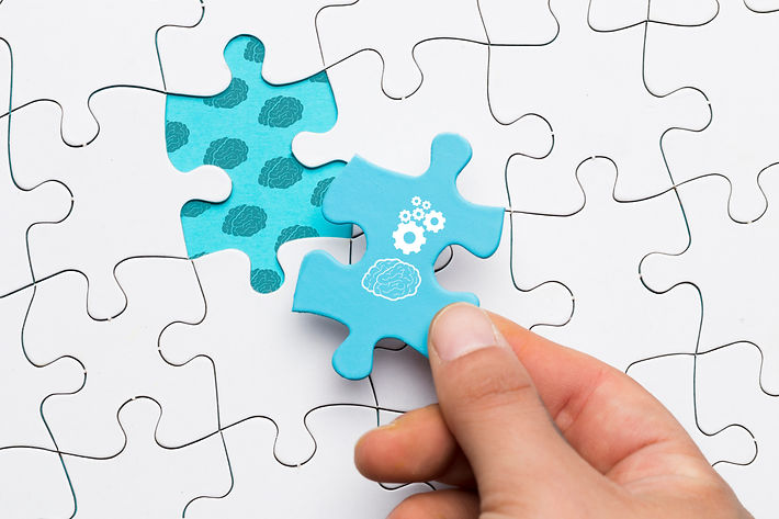 close-up-human-hand-holding-blue-puzzle-piece-with-brain-cogwheel-drawing.jpg