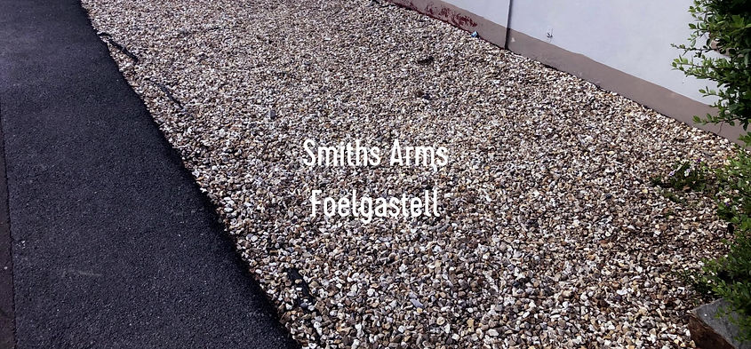 Freshing up and making safe the Smiths Arms front garden area