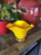Yellow with red bowl