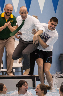 William & Mary Swim coach is dragged into the pool after winning a swimm meet