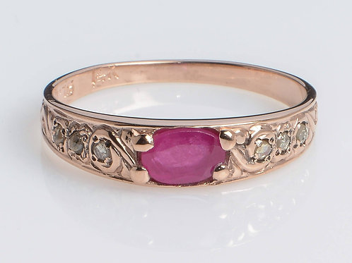 Sentimental band of 14K Rose gold is set with a ruby and diamonds