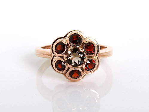 Flower Shaped Ring with a central smoky topaz surrounded by Garnet